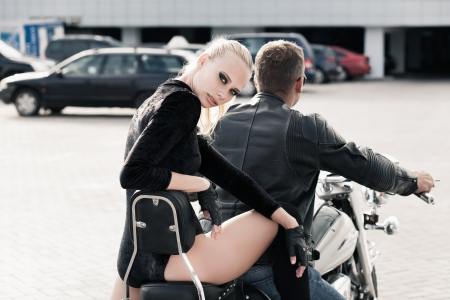 Bikers couple riding on motorcycle photo