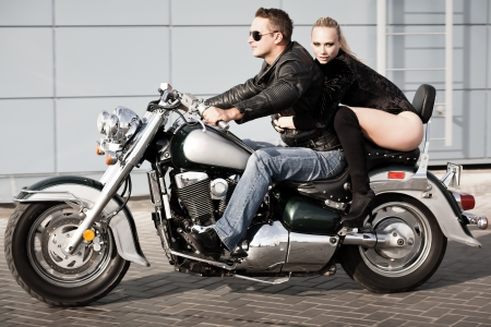 sexy girl sitting: Bikers couple riding on motorcycle  Shot in motion