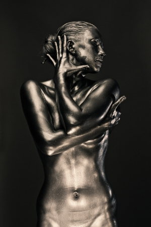 nude woman posing: Nude woman like statue in liquid metal posing Stock Photo