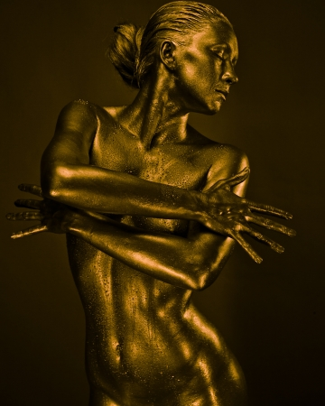 nude wet: Nude woman like statue in liquid metal posing Stock Photo
