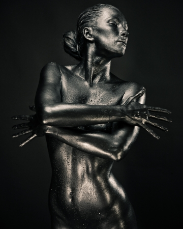 nude ass: Nude woman like statue in liquid metal posing Stock Photo