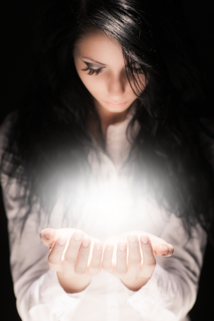 Young girl with something magic in her hands