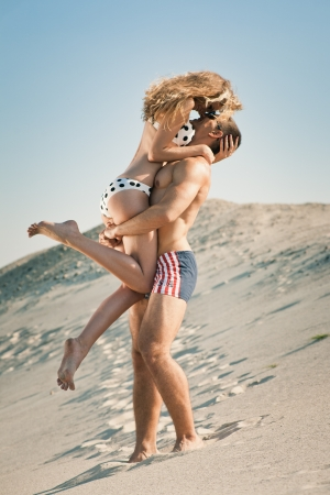 Attractive young heterosexual couple on beach photo