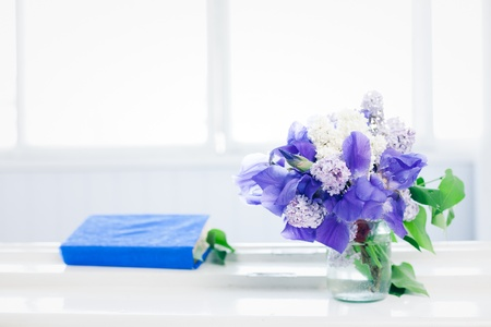 Simple still life - book and bouquet on window Stock fotó