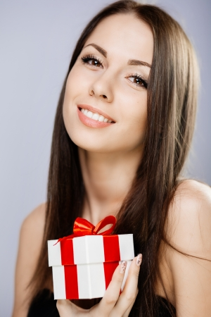 Portrait of gorgeous brunette with gift box photo