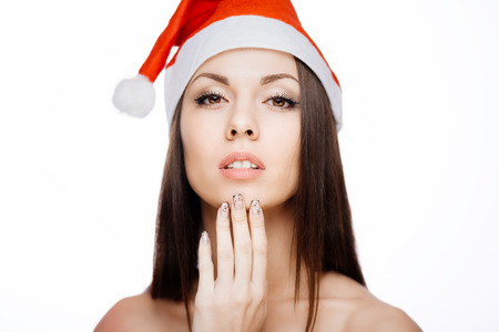 Gorgeous cheerful santa girl isolated on white photo
