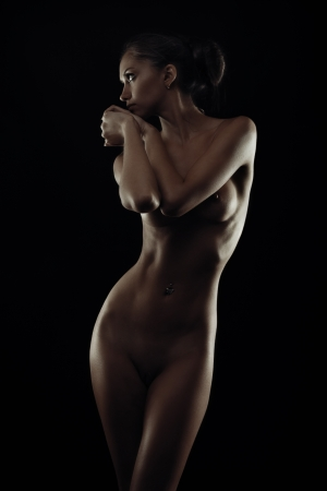 naked black women: Perfect body silhouette of young woman isolated on black