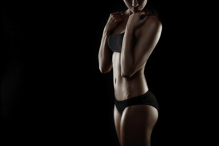 Portrait of fitness lady isolated on black Stock Photo