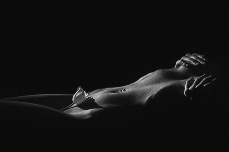 sexy nude girl: Beautiful body of young woman, isolated on black. Black and white