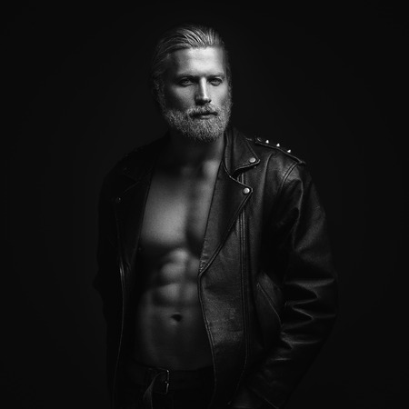 shirtless man: Artistic portrait of gray haired man on black background