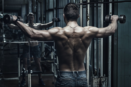 a workout: Young handsome athlete in old rusty gym