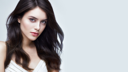 gorgeous girl: Fashion portrait of young gorgeous brunette with wind in hair