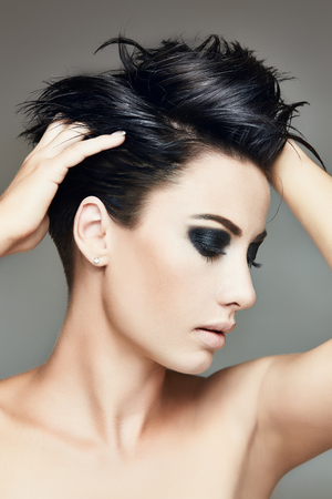 Fashion portrait of stylish brunette woman with smokey eyes