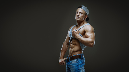 model male: Artistic portrait of young handsome muscular man