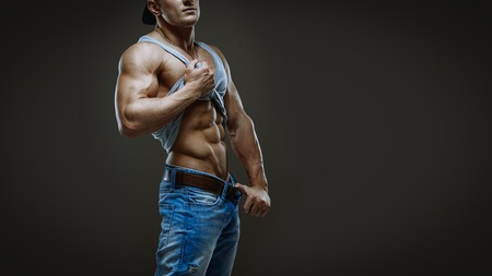 Artistic portrait of young handsome muscular man