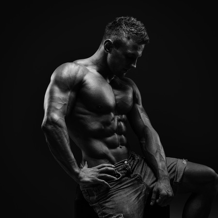 sexy abs: Artistic portrait of young handsome muscular man
