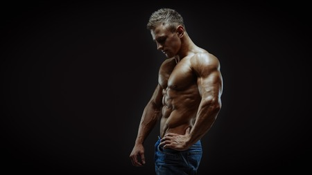 blond: Artistic portrait of young handsome muscular man
