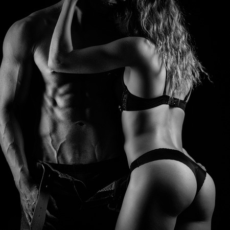 Artistic photo of fitness couple hugging. Black and white Stock Photo
