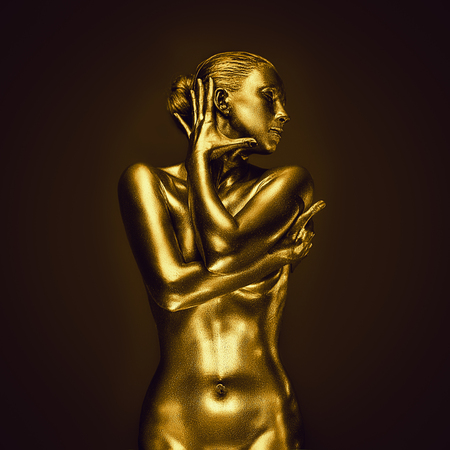 Golden naked feminine woman like statue posing on dark background