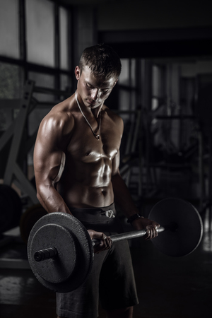 Fitness guy with barbell
