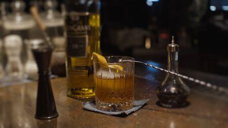 Alcohol cocktail with orange peel