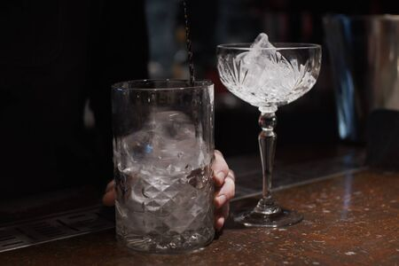 Mixing ice in glass