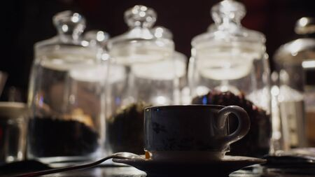 Silhouette of cup of tea on background with tea glass bulbs