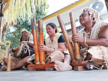 Indigenous tribe playing bamboo musical instrument Reklamní fotografie
