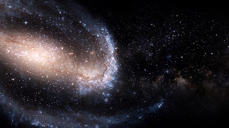 galaxy a system of millions or billions of stars, together with gas and dust, held together by gravitational attraction. Stock fotó