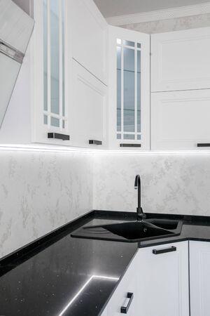Modern gourmet kitchen interior. Beautiful white design Stock Photo