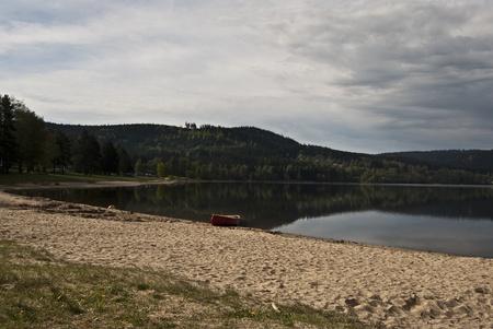lipno: Lipno river dam, sandy beach and small boat Stock Photo