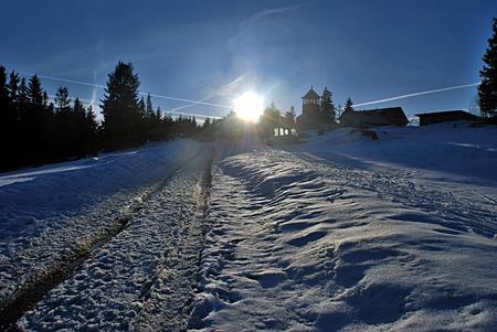 clear path: sunset in winter Moravskoslezske Beskydy mountains Stock Photo
