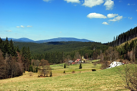 hamlets: hamlets on mountain meadows with nice mountains panorama with blue sky in Moravskoslezske Beskydy mountains