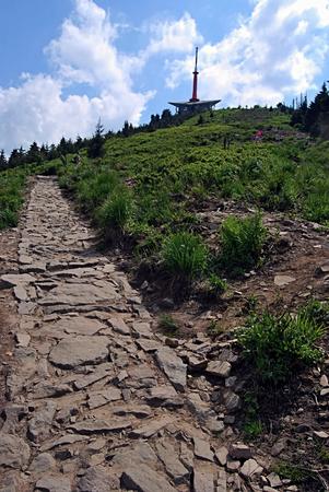stony footpath eith Lysa hora hill in Moravskoslezske Beskydy mountains