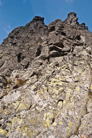 orla: Zleb Kulczynskiego on Orla Perc hiking trail with sharp peak above in Tatry mountains