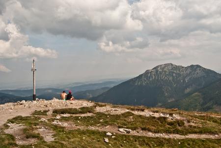 tatry: hikers relaxing on Trzydniowianski Wierch in Tatry mountains