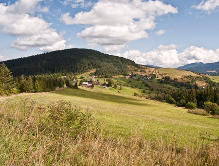 velke: autumn Carpathian mountains landscape near Velke Borove village in Slovakia with mix of meadows, forest and hills Stock Photo