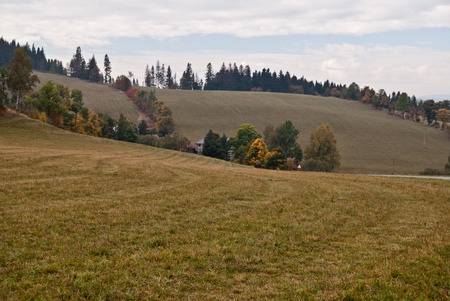 fields and meadows: autumn countryside with fields, meadows, colourful trees and hills near Karlovice village in Jeseniky region