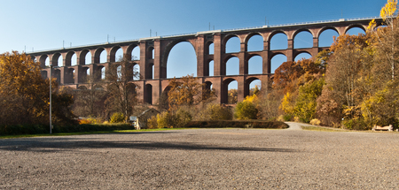 wold: Goltzschtalbrucke - wold largest brick bridge near Plauen city in Saxony with colorful autumn trees and clear sky