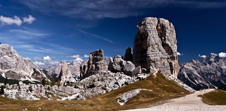 torri: famous Cinque Torri towers near Cortina dAmpezzo in Dolomites with hiking trail and nice sky with only few cluds Stock Photo