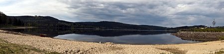 lipno: panorama of Lipno water reservoir in South Bohemia with sandy beach, canoe and hills