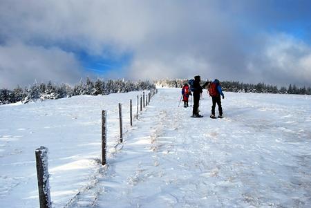 steiermark: snowshoeing in winter Fischbacher Alpen bellow Stuhleck peak in Styria