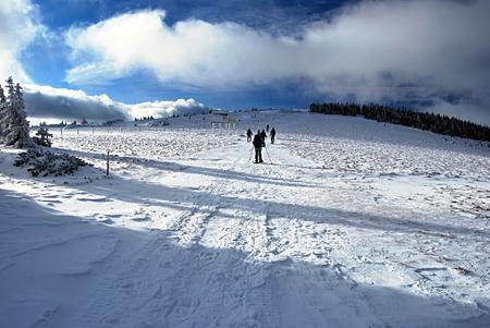 alpen: snowshoeing in winter Fischbacher Alpen mountains in Styria