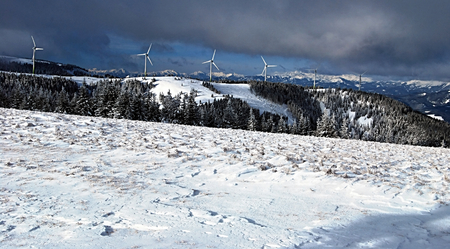 alpen: nice winter day in Fischbacher Alpen with find farm and higher austrian alps mountain ranges panorama Stock Photo
