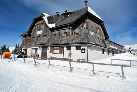 alpen: Roseggerhaus chalet in winter Fischbacher Alpen mountains bellow Pretulalpe hill near Murzzuschlag city in Styria with blue sky Editorial