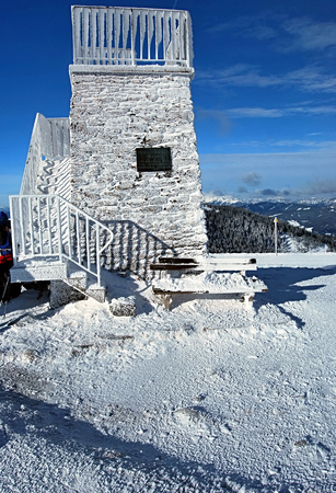 alpen: lookout on Pretulalpe hill in winter Fischbacher Alpen mountains above Murzzuschlag city in Styria Stock Photo