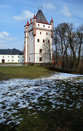 19th: Bila vez tower built in 19th century in chateau park in Hradec nad Moravici near Opava city during late winter day