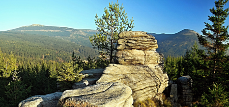 krkonose: rock formation on Pevnost hill with mountain range panorama in autumn Krkonose mountains with clear sky near Spindleruv Mlyn