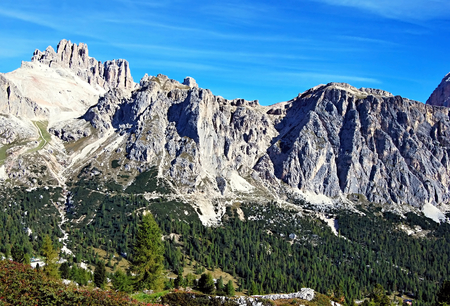 bos: Lagazuoi Grande, Cima Falzarego, Col de Bos and Rozes mountain peaks in Tofana mountain group in Dolomites near Passo Falzarego during autumn day with clear sky Stock Photo