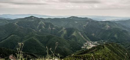 hill range: Starohorske vrchy mountain range and Stare Hory village from Majerova skala hill in Velka Fatra mountains in Slovakia